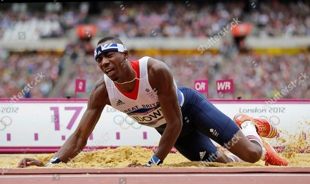 Britain's Phillips Idowu competes in a men's triple jump qualification round during the athletics in the Olympic Stadium at the 2012 Summer Olympics, London