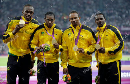 Usain Bolt Jamaica's Nesta Carter, Michael Frater, Usain Bolt and Yohan Blake celebrate as they receive their gold medals for the men's 4x100-meter during the athletics in the Olympic Stadium at the 2012 Summer Olympics, London