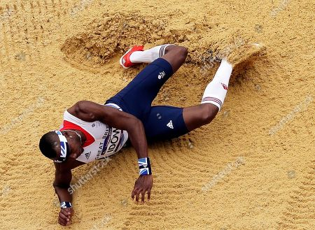 Great Britain's Phillips Idowu makes an aattempt during men's triple jumps qualifications during the athletics in the Olympic Stadium at the 2012 Summer Olympics, London