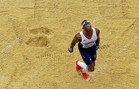 Great Britain's Phillips Idowu reacts after making an attempt during men's triple jumps qualifications at athletics in the Olympic Stadium at the 2012 Summer Olympics, London