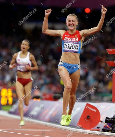 Russia's Yuliya Zaripova celebrates as she wins the women's 3000-meter steeplechase during the athletics in the Olympic Stadium at the 2012 Summer Olympics, London