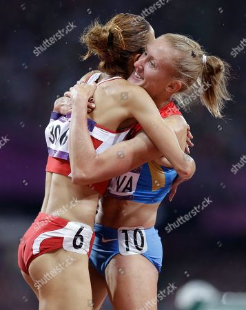 Russia's Yuliya Zaripova, right, embraces Tunisia's Habiba Ghribi as she celebrates her win in the women's 3000-meter steeplechase ahead of during the athletics in the Olympic Stadium at the 2012 Summer Olympics, London