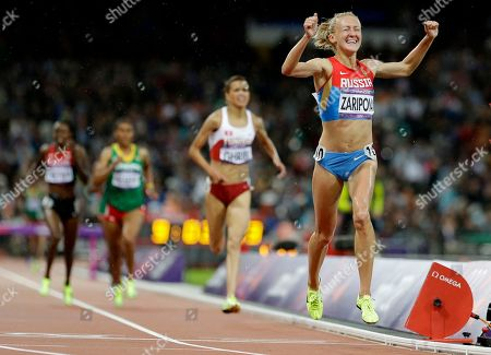 Russia's Yuliya Zaripova celebrates as she crosses the finish line to win the women's 3000-meters steeplechase during the athletics in the Olympic Stadium at the 2012 Summer Olympics, London