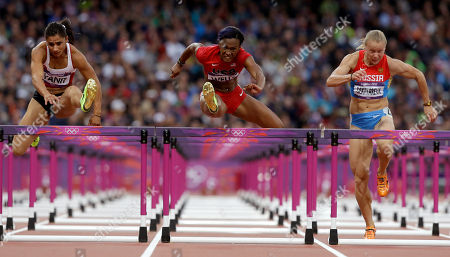 Turkey's Nevin Yanit, left, United States' Kellie Wells, center, and Russia's Tatyana Dektyareva compete in a women's 100-meter hurdles semifinal during the athletics in the Olympic Stadium at the 2012 Summer Olympics, London