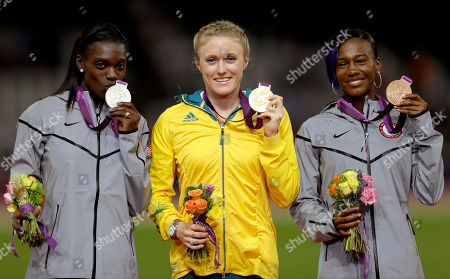 Australia's Sally Pearson, center, poses for photographers after receiving her gold medal with silver medalist United States' Dawn Harper, left, and bronze medalist compatriot Kellie Wells for the women's 100-meter hurdles during the athletics in the Olympic Stadium at the 2012 Summer Olympics, London