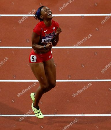 United States' Kellie Wells reacts after finishing third in the women's 100-meter hurdles during the athletics in the Olympic Stadium at the 2012 Summer Olympics, London