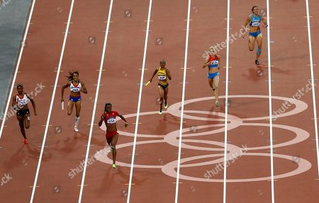 United States' Deedee Trotter leads in the Women's 4 x 400-meter relay during the athletics in the Olympic Stadium at the 2012 Summer Olympics, London