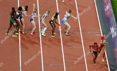 United States' Deedee Trotter and United States' Allyson Felix do a handoff to take the lead in the women's 4 x 400-meter relay during the athletics in the Olympic Stadium at the 2012 Summer Olympics, London