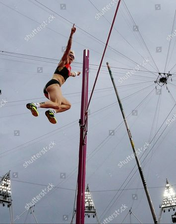 Germany's Martina Strutz gestures as she clears the bar in the women's pole vault final during the athletics in the Olympic Stadium at the 2012 Summer Olympics, London