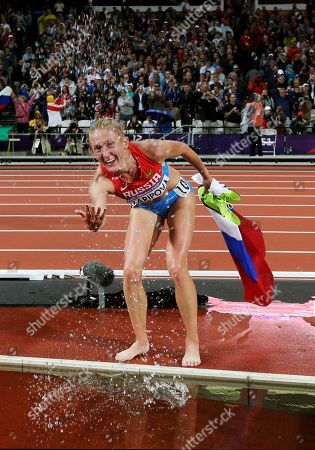 Russia's Yuliya Zaripova celebrates winning gold in the women's 3000-meter steeplechase final during the athletics in the Olympic Stadium at the 2012 Summer Olympics, London