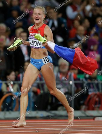 Russia's Yuliya Zaripova celebrates winning gold for the women's 3000-meter steeplechase final during the athletics in the Olympic Stadium at the 2012 Summer Olympics, London