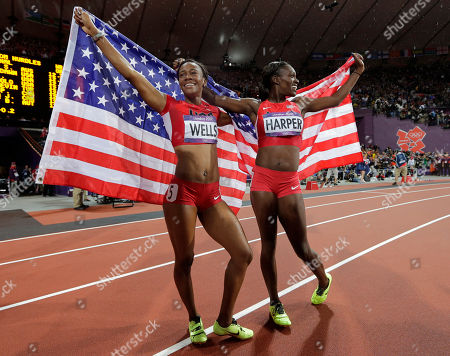 United States' Dawn Harper, left, celebrates winning silver with bronze medallist Kellie Wells of the United States following the women's 100-meter hurdles final during the athletics in the Olympic Stadium at the 2012 Summer Olympics, London