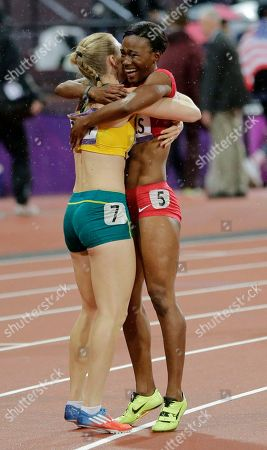 Australia's Sally Pearson, left, is embraced by bronze medallist Kellie Wells of the United States after she won gold in the women's 100-meter hurdles final during the athletics in the Olympic Stadium at the 2012 Summer Olympics, London