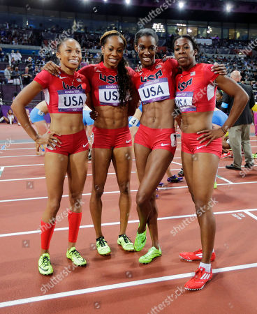 From left, United States' Allyson Felix, United States' Sanya Richards-Ross, United States' Deedee Trotter and United States' Francena McCorory pose for photographers after winning gold in the women's 4x400-meter relay final during the athletics in the Olympic Stadium at the 2012 Summer Olympics, London