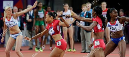 United States' DeeDee Trotter, second from right, hands the baton to United States' Allyson Felix as they compete to win gold in the women's 4x400-meter relay final during the athletics in the Olympic Stadium at the 2012 Summer Olympics, London