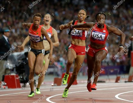 United States' Allyson Felix, second from right, passes to United States' Bianca Knight, right, in the women's 4x100-meter final during the athletics in the Olympic Stadium at the 2012 Summer Olympics, London, . The United States relay team set a new world record with a time of 40.82 seconds