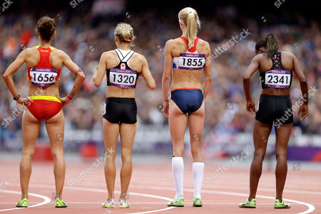 From left to right, Spain's Natalia Rodriguez, Canada's Hilary Stellingwerff, Britain's Hannah England, and Kenya's Hellen Osando Obiri prepare to compete in a women's 1500- meter heat during the athletics competition in the Olympic Stadium at the 2012 Summer Olympics, London