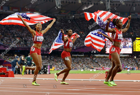 United States' women's 4 x100-meter relay team members Allyson Felix, Carmelita Jeter, Bianca Knight, and Tianna Madison celebrate their gold medal win during the athletics in the Olympic Stadium at the 2012 Summer Olympics, London, . The United States relay team set a new world record with a time of 40.82 seconds