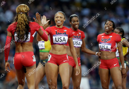 United States' Sanya Richards-Ross, left, celebrates with teammate United States' Allyson Felix, second left, with teammates Francena McCorory, right, and Deedee Trotter after their gold medal win in the women's 4 x 400-meter relay during the athletics in the Olympic Stadium at the 2012 Summer Olympics, London