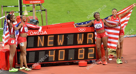 United States' women's relay team from left, Tianna Madison, Carmelita Jeter, Bianca Knight, and Allyson Felix pose for a photo by the clock showing their world record time, during the athletics in the Olympic Stadium at the 2012 Summer Olympics, London