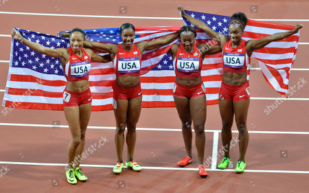 United States' women's 4 x 100-meter relay team members from left, United States' Allyson Felix, Carmelita Jeter, Bianca Knight, and Tianna Madison pose with their national flag after their gold medal win during the athletics in the Olympic Stadium at the 2012 Summer Olympics, London, . The United States relay team set a new world record with a time of 40.82 seconds