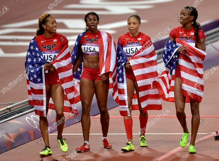 United States' women's relay team members from left, Sanya Richards-Ross, Francena McCorory, Allyson Felix, and Deedee Trotter wear their national flag after their gold medal win in the 4 x 400-meter relay during the athletics in the Olympic Stadium at the 2012 Summer Olympics, London