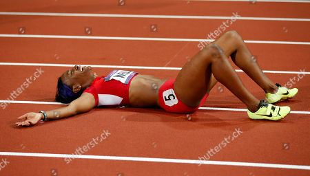 United States' Kellie Wells reacts after winning bronze in the women's 100-meter hurdles final during the athletics in the Olympic Stadium at the 2012 Summer Olympics, London