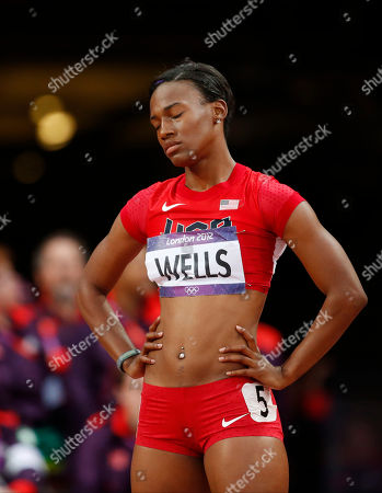 United States' Kellie Wells prepares for a women's 100-meter hurdles semifinal during the athletics in the Olympic Stadium at the 2012 Summer Olympics, London