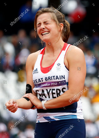 Britain's Goldie Sayers reacts after taking a throw in a women's javelin throw qualification round during the athletics in the Olympic Stadium at the 2012 Summer Olympics, London