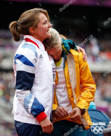 Britain's Goldie Sayers, left, and Australia's Kimberley Mickle embrace during a women's javelin throw qualification round during the athletics in the Olympic Stadium at the 2012 Summer Olympics, London
