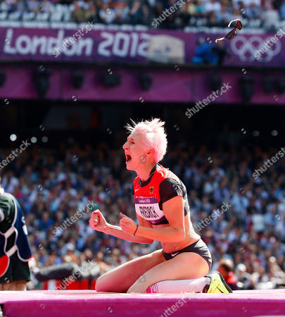 Germany's Ariane Friedrich reacts after clearing the bar in a women's high jump qualification round during the athletics in the Olympic Stadium at the 2012 Summer Olympics, London