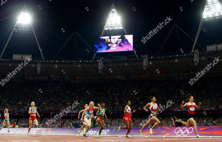 Turkey's Asli Cakir Alptekin, right, reacts as she crosses the finish line to win the women's 1500-meter final during the athletics in the Olympic Stadium at the 2012 Summer Olympics, London