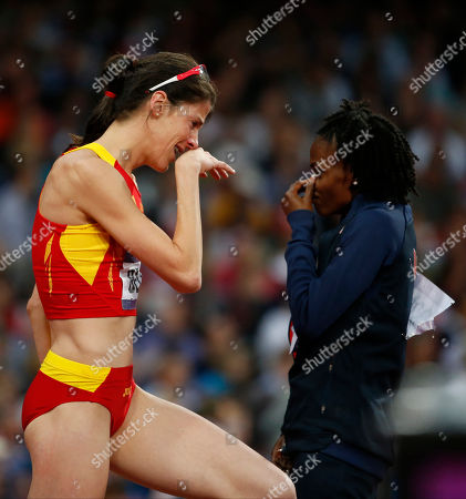 Spain's Ruth Beitia, left, and United States' Chaunte Lowe react in the women's high jump final during the athletics in the Olympic Stadium at the 2012 Summer Olympics, London