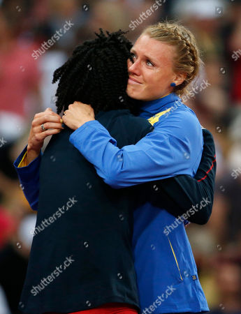 United States' Chaunte Lowe, left, and Sweden's Emma Green Tregaro embrace during the women's high jump final during the athletics in the Olympic Stadium at the 2012 Summer Olympics, London