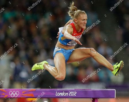 Russia's Yuliya Zaripova clears the obstacle in the women's 3000-meter steeplechase final during the athletics in the Olympic Stadium at the 2012 Summer Olympics, London