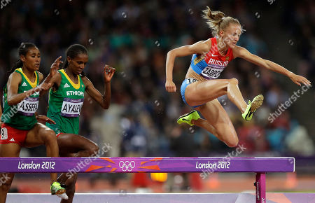 Russia's Yuliya Zaripova, right, clears the obstacle in the women's 3000-meter steeplechase final ahead of Ethiopia's Sofia Assefa, left, and Ethiopia's Hiwot Ayalew during the athletics in the Olympic Stadium at the 2012 Summer Olympics, London