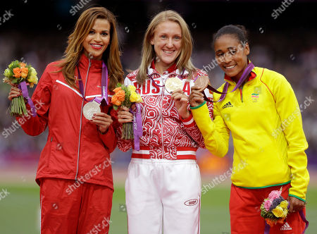 Stock Picture of Medalists in the women's 3000-meter steeplechase from left, Tunisia's Habiba Ghribi, silver, Russia's Yuliya Zaripova, gold, and Ethiopia's Sofia Assefa, bronze, pose on the podium during the athletics in the Olympic Stadium at the 2012 Summer Olympics, London