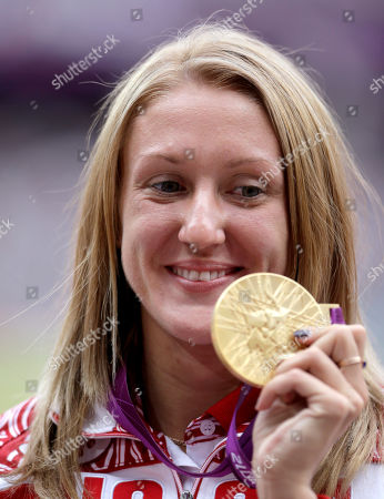 Russia's Yuliya Zaripova poses with her gold medal in the women's 3000-meter steeplechase during the athletics in the Olympic Stadium at the 2012 Summer Olympics, London