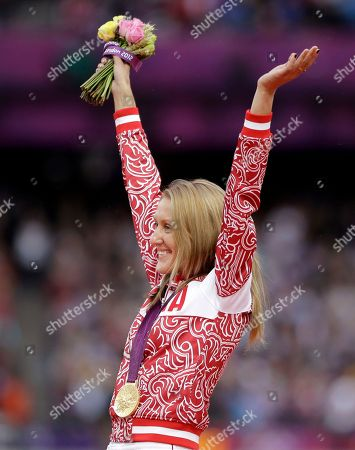 Stock Image of Russia's Yuliya Zaripova waves from the podium after being presented with the gold medal in the women's 3000-meter steeplechase during the athletics in the Olympic Stadium at the 2012 Summer Olympics, London