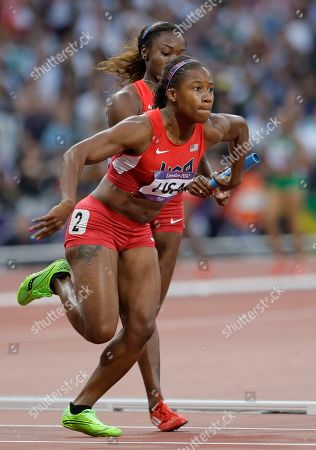 United States' Lauryn Williams gets the baton from her teammate Bianca Knight in a women's 4x100-meter relay heat during the athletics in the Olympic Stadium at the 2012 Summer Olympics, London