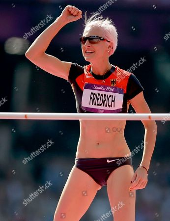 Germany's Ariane Friedrich reacts after competing in a women's high jump qualification round during the athletics in the Olympic Stadium at the 2012 Summer Olympics, London