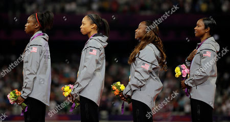 USA's Tianna Madison, Allyson Felix, Bianca Knight and Carmelita Jeter listen to the national anthem as they celebrate their gold medal win after the women's 4x100-meter during the athletics in the Olympic Stadium at the 2012 Summer Olympics, London