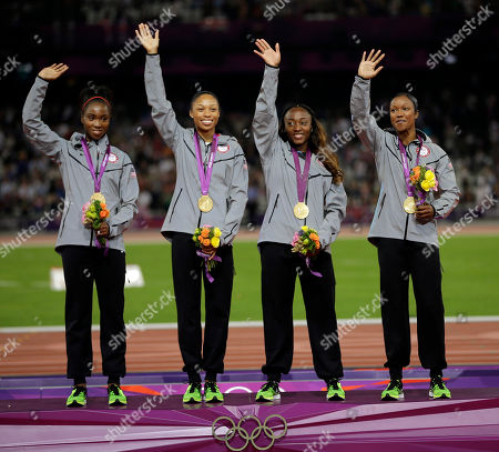 USA's Tianna Madison, Allyson Felix, Bianca Knight and Carmelita Jeter celebrate their gold medal win after the women's 4x100-meter during the athletics in the Olympic Stadium at the 2012 Summer Olympics, London