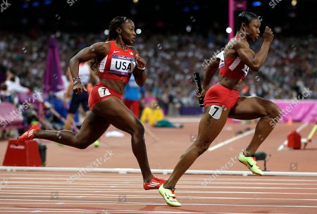United States' Carmelita Jeter takes the baton from teammate Bianca Knight for the final leg of the women's 4 X 100-meter relay during the athletics in the Olympic Stadium at the 2012 Summer Olympics, London