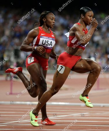 United States' Carmelita Jeter, right, takes the baton from teammate Bianca Knight for the final leg of the women's 4x100-meter relay final during the athletics in the Olympic Stadium at the 2012 Summer Olympics, London