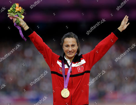 Turkey's Asli Cakir Alptekin poses with her gold medal for the women's 1500-meter during the athletics in the Olympic Stadium at the 2012 Summer Olympics, London