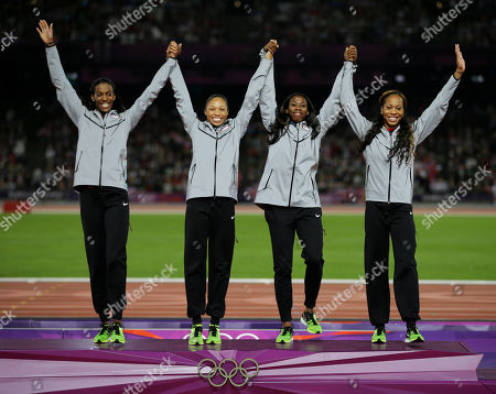 USA's DeeDee Trotter, Allyson Felix, Francena McCorory and Sanya Richards-Ross react before receiving their gold medals for the women's 4x400-meter during the athletics in the Olympic Stadium at the 2012 Summer Olympics, London