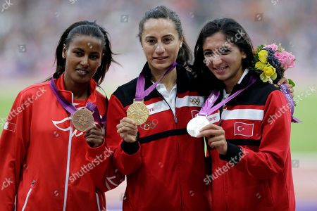 Turkey's Asli Cakir Alptekin is flanked by Turkey's Gamze Bulut, right, and Bahrain's Maryam Yusuf Jamal pose with their medals for the women's 1500-meter during the athletics in the Olympic Stadium at the 2012 Summer Olympics, London