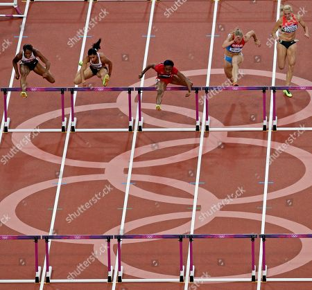 USA's Kellie Wells leads her heat in the women's 100-meter hurdle semifinals during the athletics in the Olympic Stadium at the 2012 Summer Olympics, London