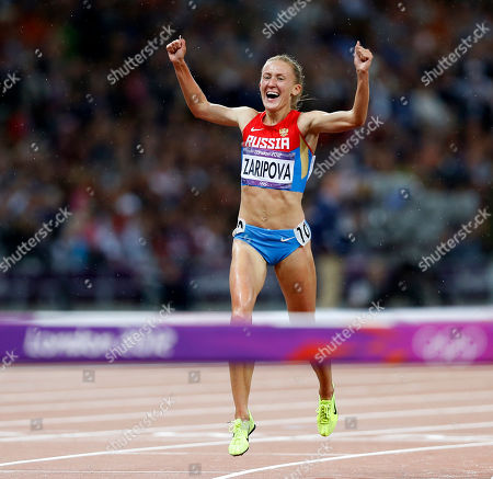 Russia's Yuliya Zaripova reacts as she wins the gold medal in the women's 3000-meter steeplechase during the athletics in the Olympic Stadium at the 2012 Summer Olympics, London